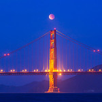 """""""Lunar Eclipse over the Golden Gate"""" I went out at sunrise this morning not sure what to expect! What an awesome sight! The blue skies at sunrise with the red moon overhead were just a sight to watch! It was worth the 3am start to our fun shooting!"""