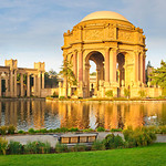 """Early Morning at the Palace of Fine Arts"" After I shot the lunar eclipse over the Golden Gate Bridge, I headed over to the Palace of Fine Arts to get the early morning sunlight, glow and reflections on the water. This is 8 images stitched together in a 1:3 ratio panorama and should look great printed as a 20:60 or triptych combination (two small images on the sides and one larger image with the main part of the palace. — at Palace of Fine Arts."