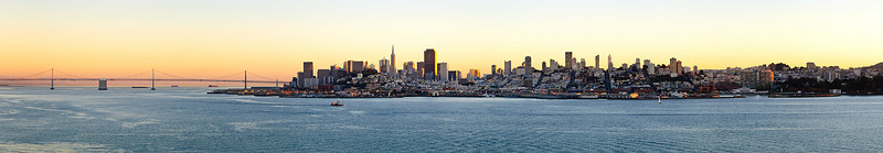 Full View of San Francisco City Scape at Sunset with Bay Bridge. Panorama shot from Alcatraz.