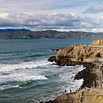 San Francisco Cliff House and Sutro Baths at the mouth of the Golden Gate Bridge