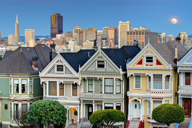 7 Painted Ladies in San Francisco at Sunset with the Full Moon rising in the background.  7 Painted Ladies at Sunset with a view of Downtown San Francisco. Located in Alamo Square, the Victorian houses on Steiner Street. This is one of San Francisco's most photographed landmarks, yet I still run into people everyday who have never been here!