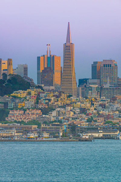 """""""San Francisco Skyline with the Mandarin Oriental Hotel and Transamerica Pyramid at Dusk""""  Just another fantastic view of the San Francisco Skyline at dusk with the glow of the sun on the Transamerica Pyramid and Mandarin Oriental Hotel.  It took me quite a few trips to get a clear day view of the Skyline without fog!!   Another day for an amazing view!"""