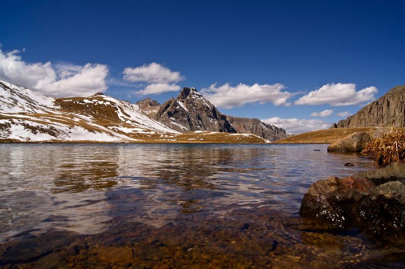 A serene afternoon scene at Upper Blue Lake high in the Mount Sneffels wilderness; Colorado San Juan Range