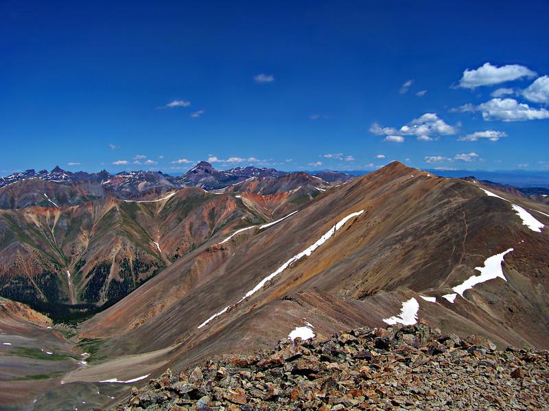 Redcloud Peak and the distant Wetterhorn and Uncompahgre Peaks viewed from the summit of Sunshine Peak; Colorado San Juan Range.