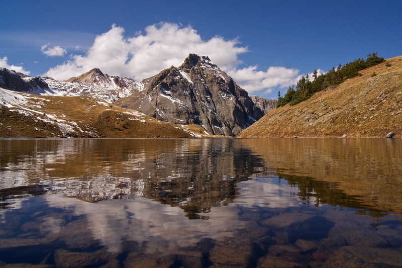 Deep in the Mount Sneffels wilderness, rugged San Juan peaks reflect off the clear waters of Middle Blue Lake.