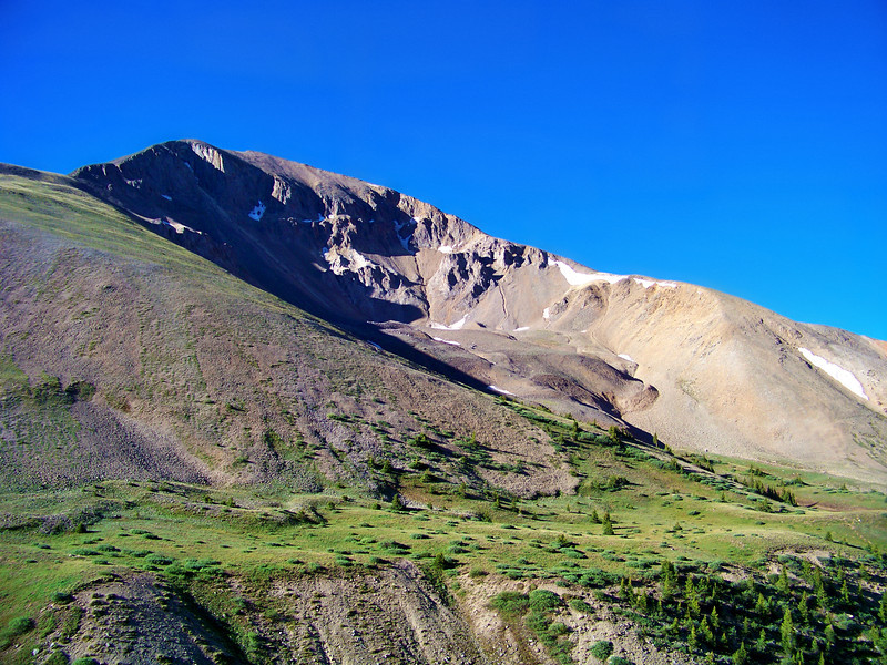 The trail to Redcloud Peak wraps around Sundog Peak (13,432 ft.) with its distinctive volcanic lava dome, Colorado San Juan Range.