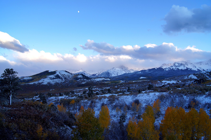 The early evening moon rises over the Sneffels Range, Colorado San Juan Mountains.
