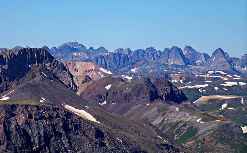 The rugged peaks of the distant southern San Juans, viewed from Sunshine Peak, Colorado.