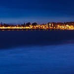 Santa Cruz Wharf and Pier next to the Santa Cruz Beach Boardwalk.  Panorama at Dusk. Northern California
