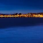 Santa Cruz Wharf and Pier next to the Santa Cruz Beach Boardwalk.  Panorama at Dusk. Northern California