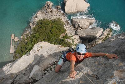 Cecile climbing at Cala Luna