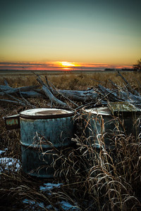 'Moved away' - Forgotten Barrels dot this property near Tuxford, Saskatchewan. I just love how farms have seemingly mundane objects that when left the land slowly swallows them back into nature.
