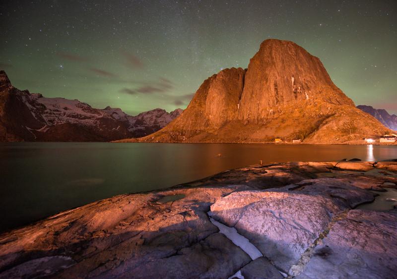 Hamnoy at night with weak aurora