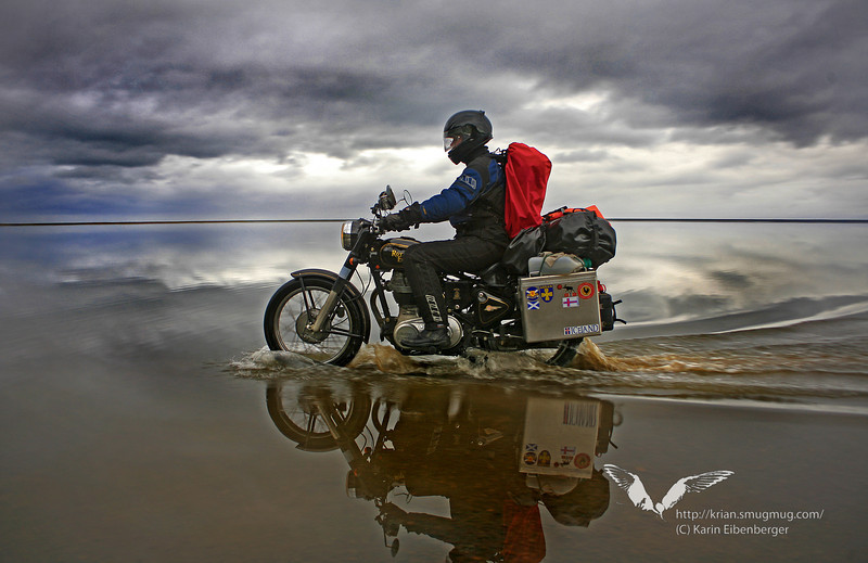 September 2008. Bernhard riding through the North Atlantic ocean in south Iceland. It was a bit hard to find the track. And a bit slippery too, causing wet toes for the photographer.