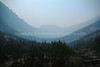 Curved gorge, Glacier Nat. Prk.  Fire smoke