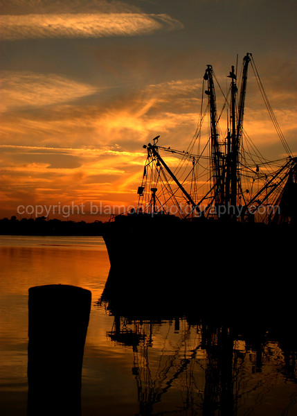 """Supper's Ready""... A docked Shrimper on the Halifax River, Daytona Beach, Fl. @ sunset... I was dining on of course, shrimps n oysters n fish, Oh My !-O...Just after the Coca Cola 300 Race in 2-08.  #1 of 2 Color.    ""Sundown dazzling day gold thru my eyes""  Lyical passage by John Wetton; From the song Starless...King Crimson's Red album."