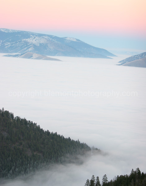 Glacial Lake Missoula, Mt... Inversion layer, shot from up Blue Mt. Looking east thru Hellgate Canyon... As the sun was setting with the freezing fog,  aka Hoar Frost... Growing on the Evergreen branches bottom left. The mountaintops are like islands.