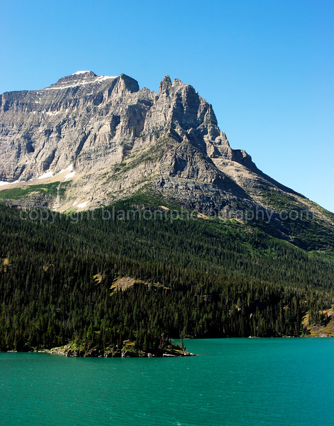 Turn you to Stone. Looking Down n Out...Little Chief Mt. along St. Marys Lake... Thats what google earth said when I tried to find out the name of this glacier ripped mountain. The mountains in Glacier Nat. Prk. were as tall as Mt. Everest at one time, say 28,000 some odd Ft. My trips to Glacier have always been short and rushed to me, never havin the time to really get to know their names, and the history behind them. I wish I had the time to spend with the Forest Rangers and their guided walks etc. It would have made me much more knowledgeable...There are so many peaks in glacier its easy to get confused. Inspired by Neil Chaput and Tim Cooper..!-)