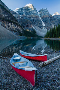 Canoeing on a calm Moraine Lake is one of the best things you can do in Banff National Park. In the heat of summer dozens of Canoes criss cross this iconic lake