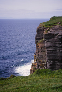 The Irish Cliffs of Moher, with a photographer hanging by his ankles!