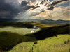 """Drakensburg Mountains in Kwazulu Natal, South Africa.  They call the sun's rays """"god beams"""".."""