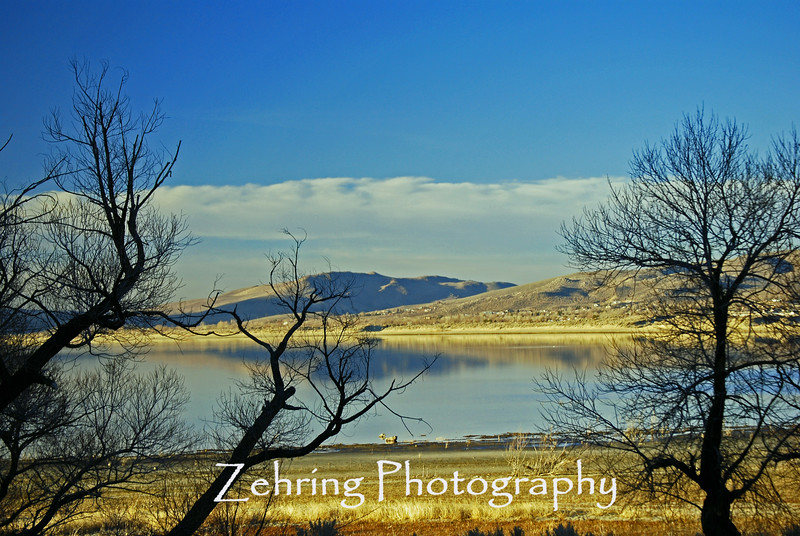 Serene sunset scene on a rare calm late afternoon at Washoe Lake, just south of Reno, NV.