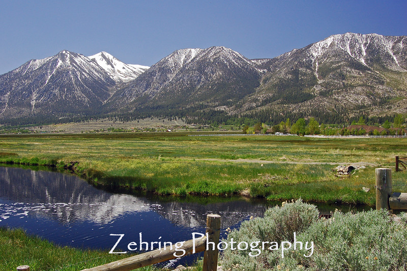 Spring comes to the valley floor, as the snow run-off brings rejuvinating water to the Nevada pasture lands.