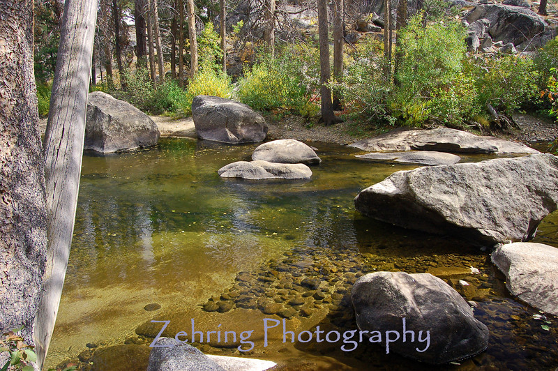 Calm pool of pristine alpine water, part of the Carson River as it flows down from Hope Valley, CA.
