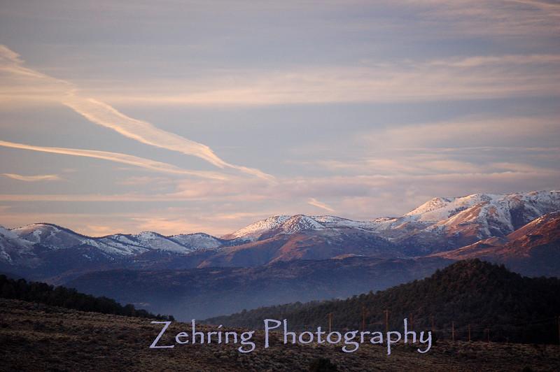 Evening sun paints a golden hue on the snow capped Sierra range