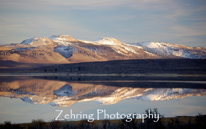 Late evening sun bathes the Sierra range as it is perfectly reflected onto Mono Lake.