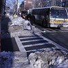 another crosswalk blocked with snow piles