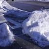 a small walkway shoveled
