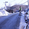 student walking in the street due to the uncleared sidewalk at the school
