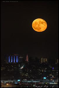 A 99% moon rising over the California Tower at Balboa Park.