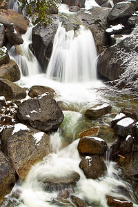 A rushing waterfall along Hwy 120 in Yosemite National Park, California