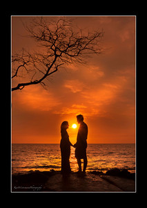 Two lovers sharing a sunset on the big Island of Hawaii