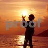 Happy Girl Holding Sun