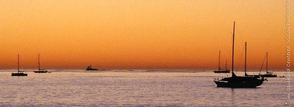 Sailboats in an Orange Dawn