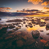 Pleasing sunset glow cast on every surface of rocks and water