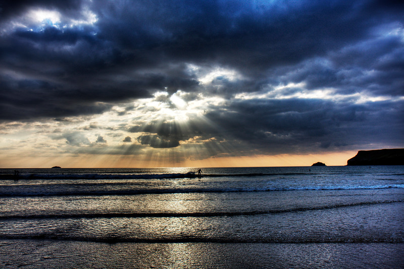 Dark surfer<br /> <br /> Not an evening for big waves... but the sun makes up for it!