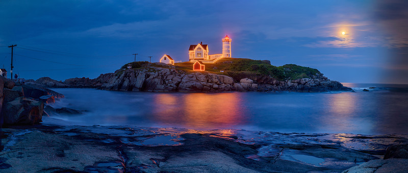 """Moonrise during """"Christmas in July"""" on August 1, 2012 at Cape Neddick """"Nubble"""" Lighthouse.  Created by stitching 10 vertical frames, each created from 4 exposure brackets, for a total of 40 source images."""