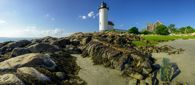 Annisquam Harbor Light Station at Wigwam Point in Gloucester, Massachusetts during late afternoon in the summer.  This image comprises multiple photos stitched and blended together to form an ultra-high-resolution panorama that is over 82 megapixels.