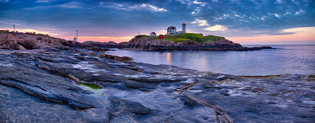"""Cape Neddick Lighthouse (""""Nubble Light"""") just before a cloudy sunrise (5:02 AM) on July 13, 2011 at Sohier Park in York, Maine.  This image comprises multiple photos stitched and blended together to form an ultra-high-resolution, high dynamic range panorama that is over 126 megapixels."""