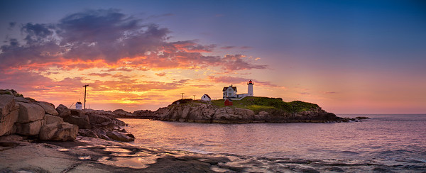 "Cape Neddick Lighthouse (""Nubble Light"") backlit by a stunning sunrise at 5:20 AM on July 13, 2011 at Sohier Park in York, Maine.  This image comprises multiple photos stitched and blended together to form an ultra-high-resolution, high dynamic range panorama that is over 109 megapixels."