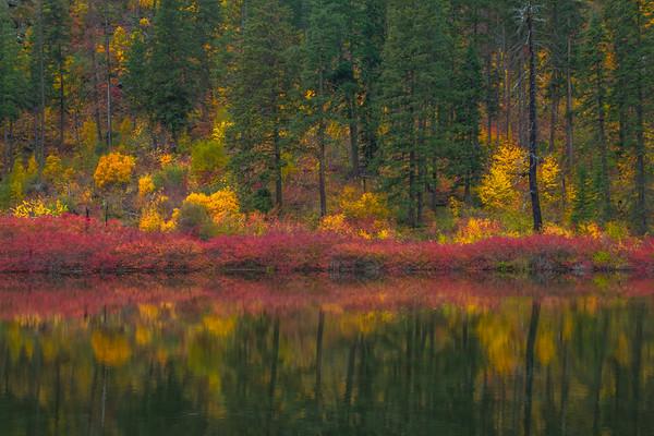 Reflections Of Vibrants Red Along Shore - Leavenworth, Central Washington, WA