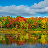 Peak Of Autumn Reflected In Shoreline Lake