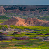 Red Stepping Rocks In Front Of Badlands - Badlands National Park, South Dakota