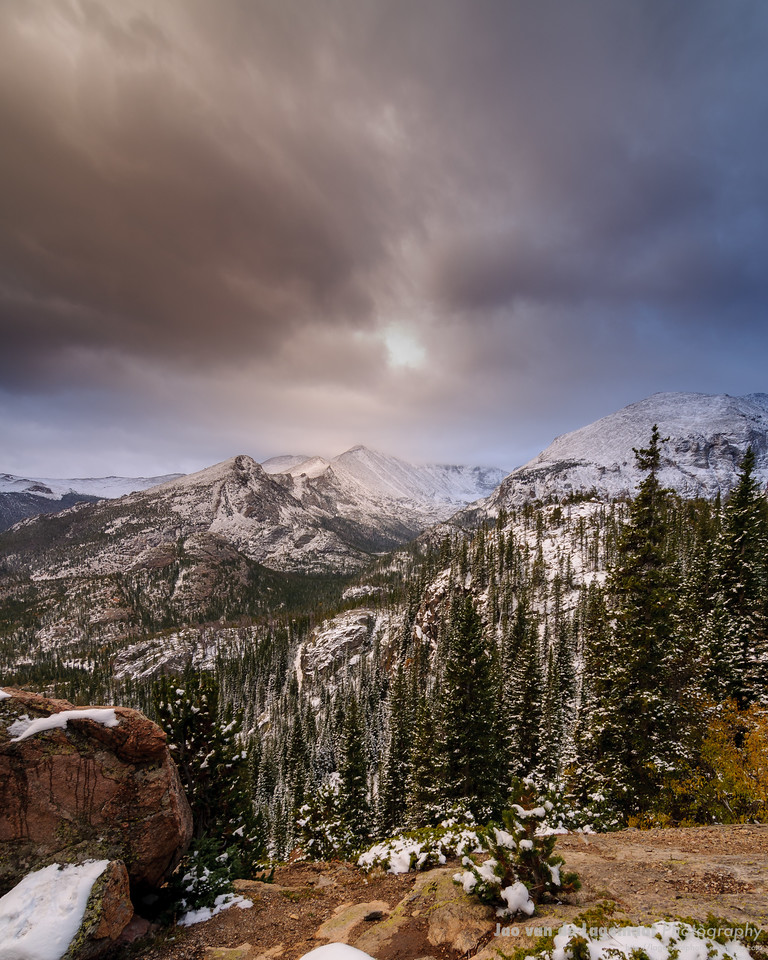 Along the trail to Lake Haiyaha - the clouds split over Longs