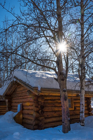 Sunburst Over Snow Cabin -Chena Hot Springs Resort, Fairbanks, Alaska