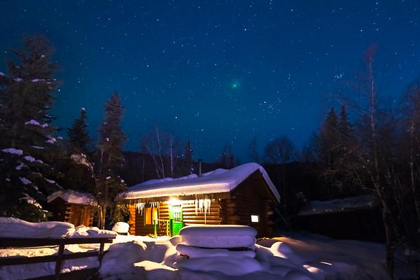 Snow Cabin Under A Blue Starry Sky -Chena Hot Springs Resort, Fairbanks, Alaska